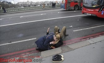 A woman assist an injured person after an incident on Westminster Bridge in London March 22 2017 REUTERS Toby Melville