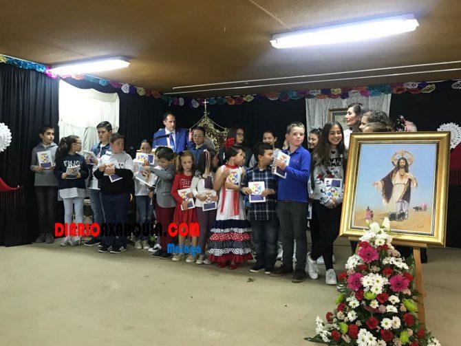 Entrega de reconocimientos por los dibujos y murales  XXI edición de la Romería al colegio Juan Paniagua de Almayate.